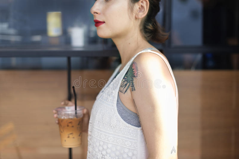 Woman Coffeeshop Drink Relaxation Tattoo Concept royalty free stock image