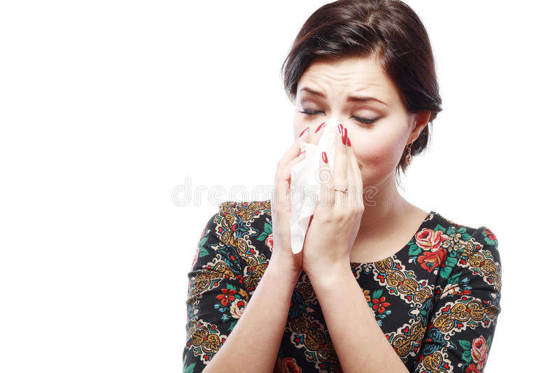 Woman with cold. Close-up portrait of a teen woman with allergy or cold stock photo