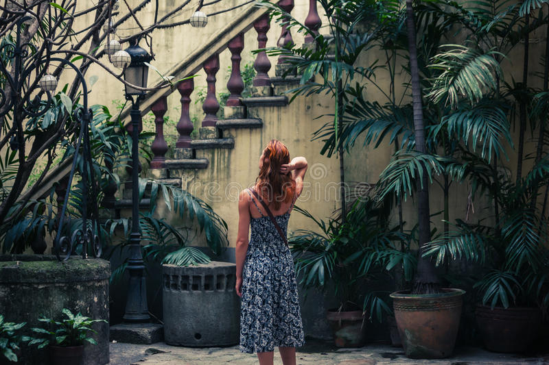 Woman by colonial staircase stock photos