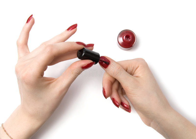 Woman color her red nails royalty free stock photos