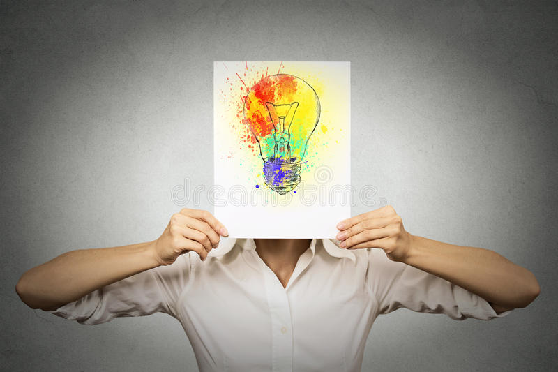Woman with colorful lightbulb covering face stock photography