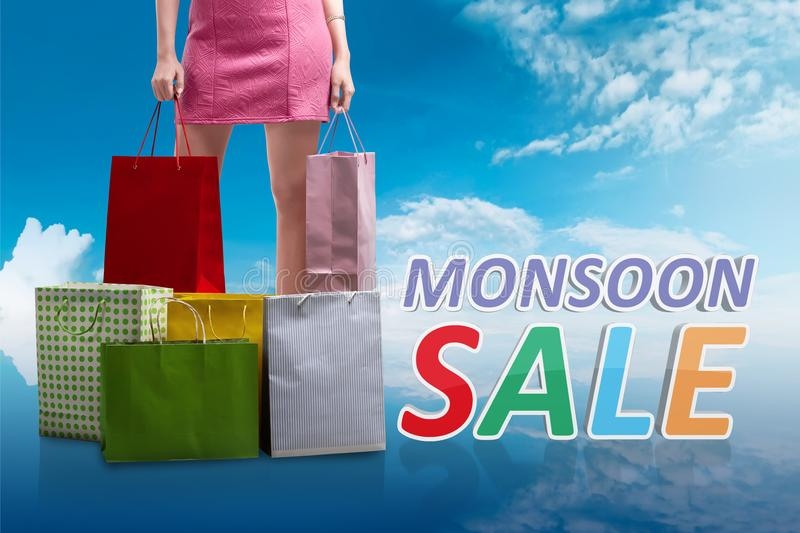 Woman with colorful paper bag on monsoon sale royalty free stock images