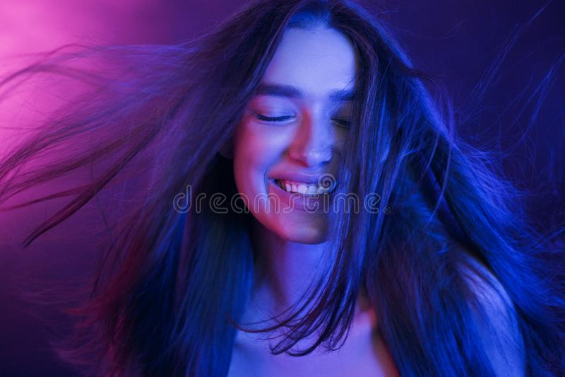 Woman Colorful Portrait. Girl playing with hair royalty free stock photo