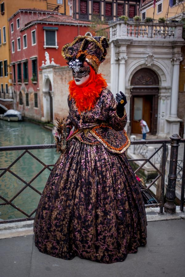 Woman with colorful Venetian costume and mask royalty free stock photos