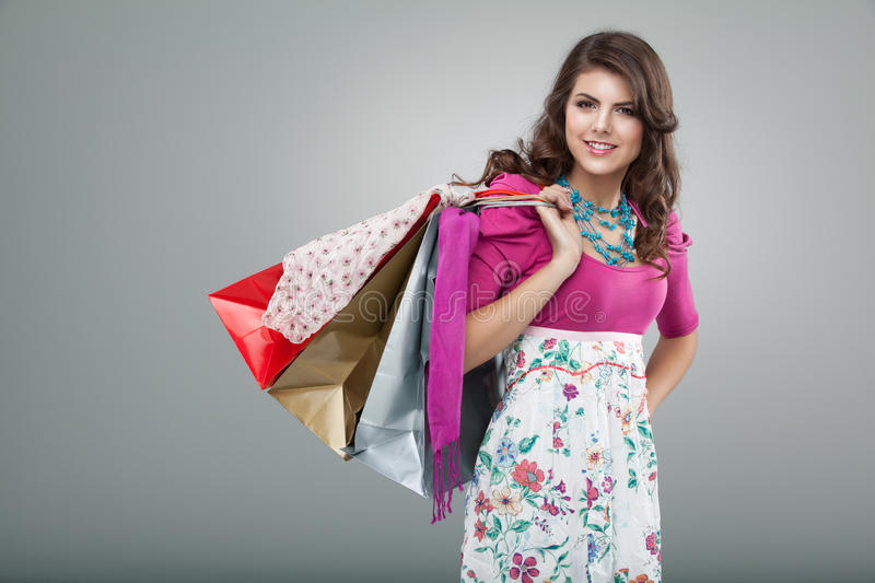 Download Woman In Colourful Outfit Holding Shopping Bags Stock Photo - Image: 18962634