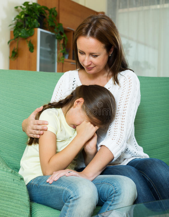 Woman comforting crying daughter royalty free stock image