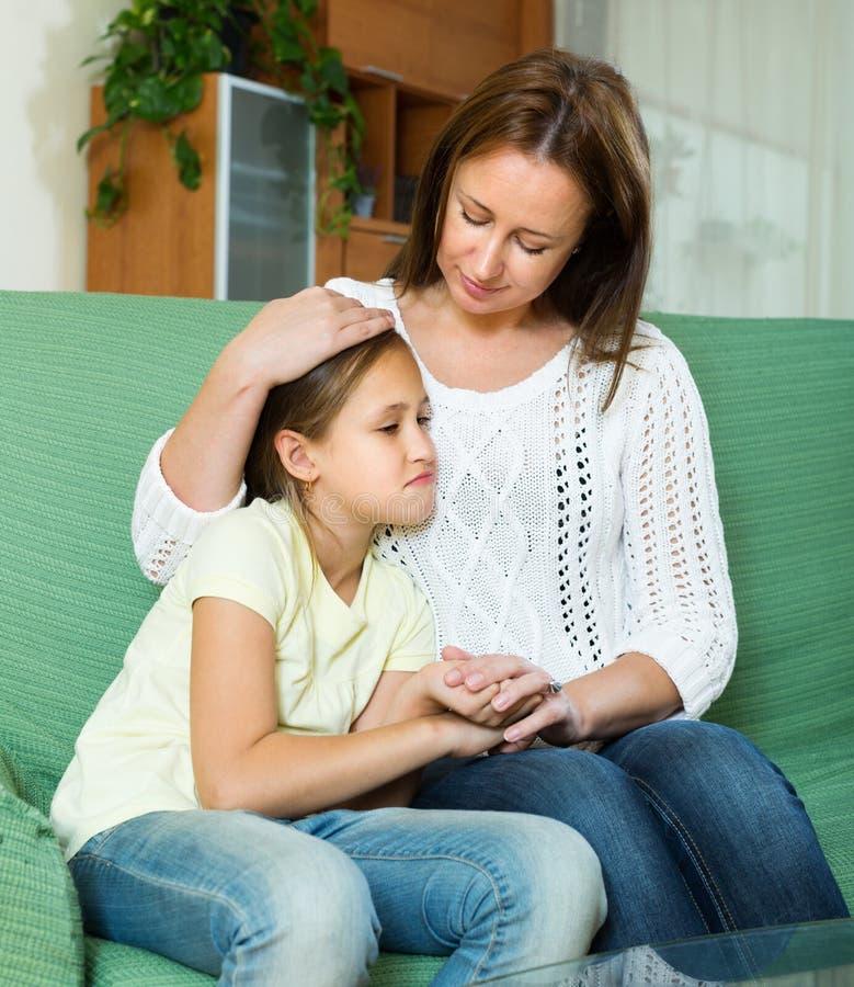 Woman comforting sad daughter royalty free stock photos