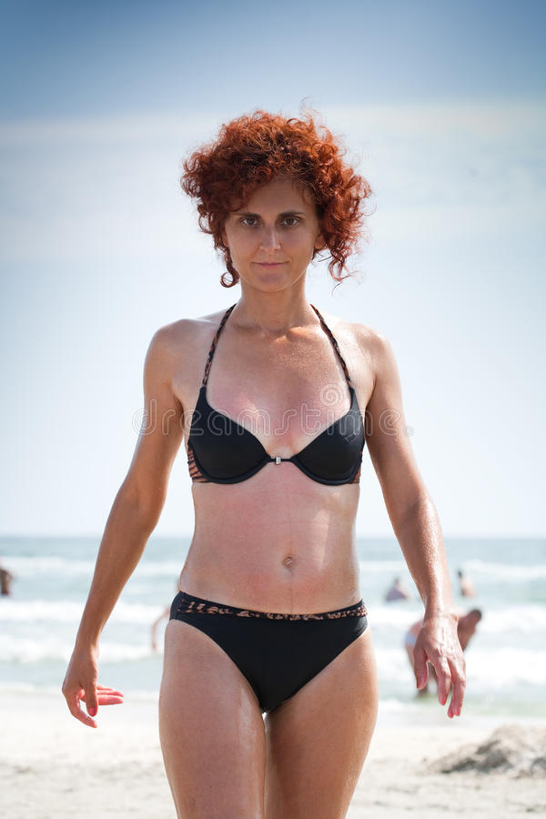 Download Woman Coming Out Of The Water Stock Photo - Image: 10284474