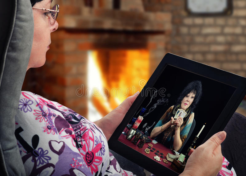 Woman communicates with fortuneteller by digital tablet royalty free stock photos