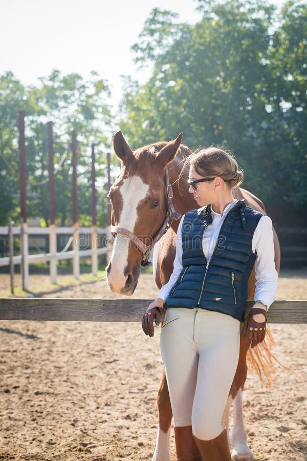 Woman communicates with a horse royalty free stock photography