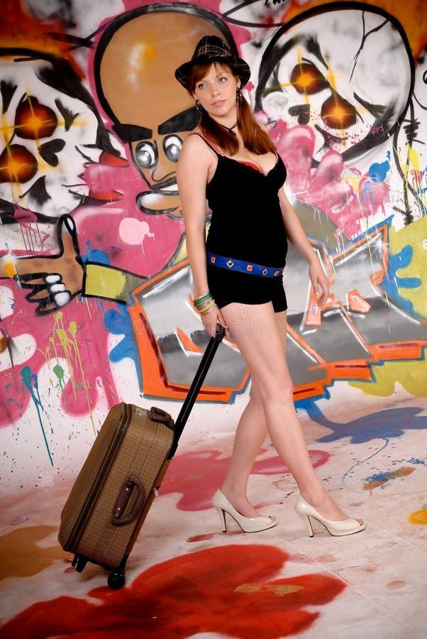 Woman commuter graffiti wall royalty free stock image