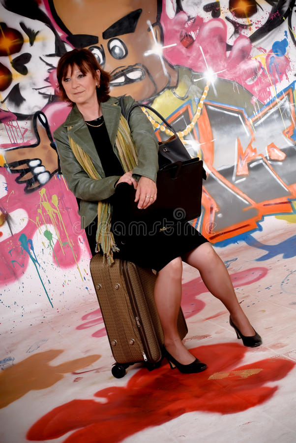 Woman commuter, urban graffiti royalty free stock photo