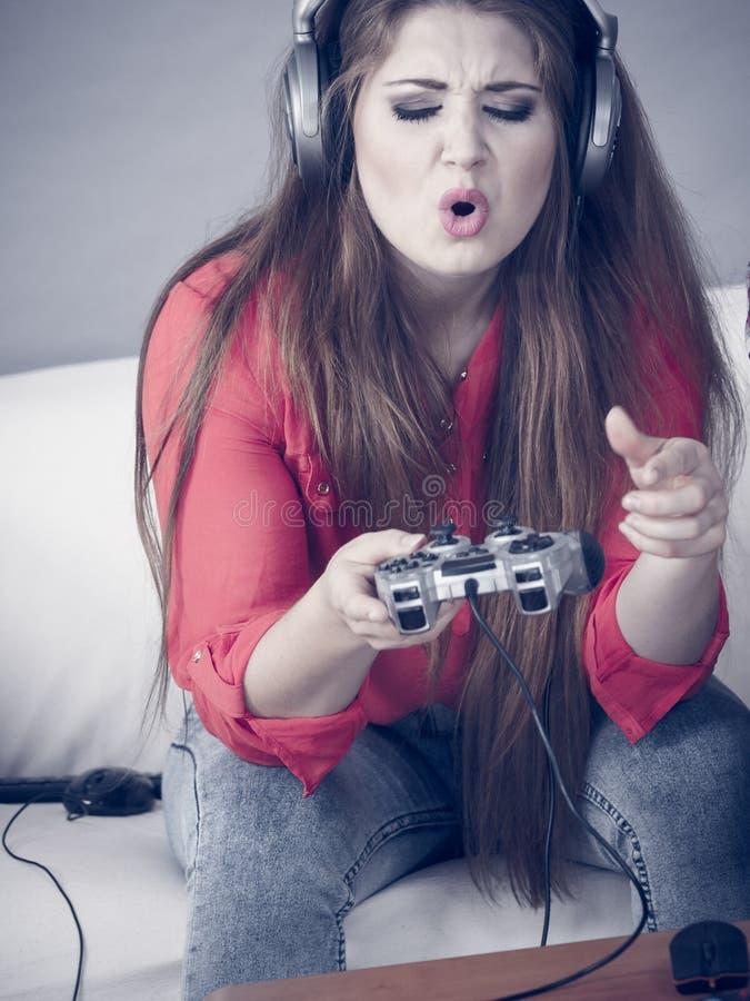 Woman complaining at gaming pad stock photography