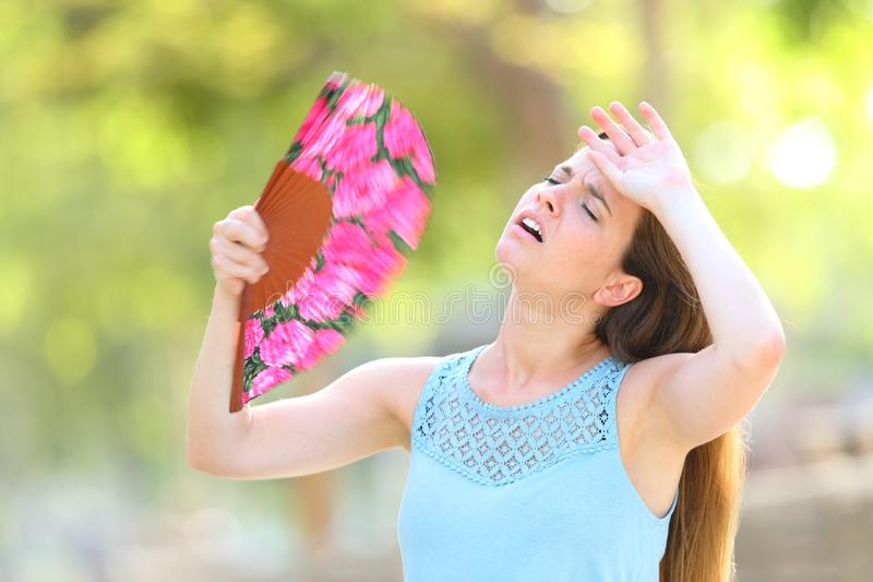 Woman complaining suffering heat stroke on summer royalty free stock images