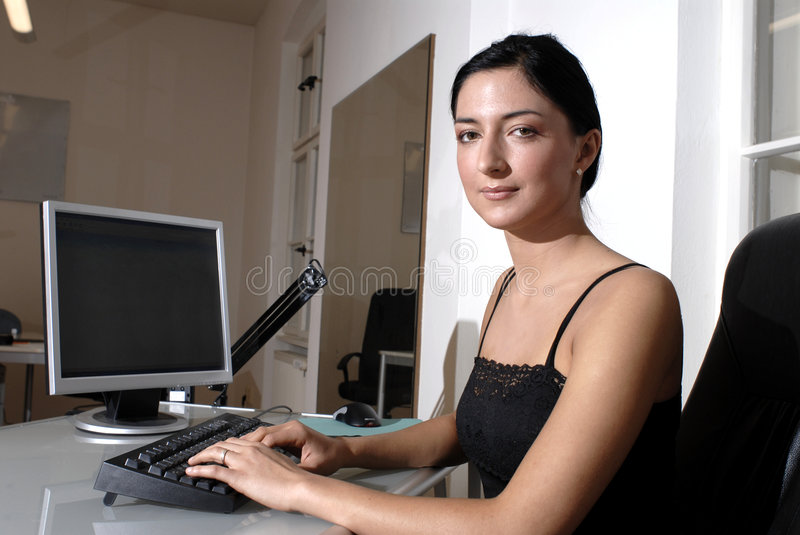 woman at computer royalty free stock images