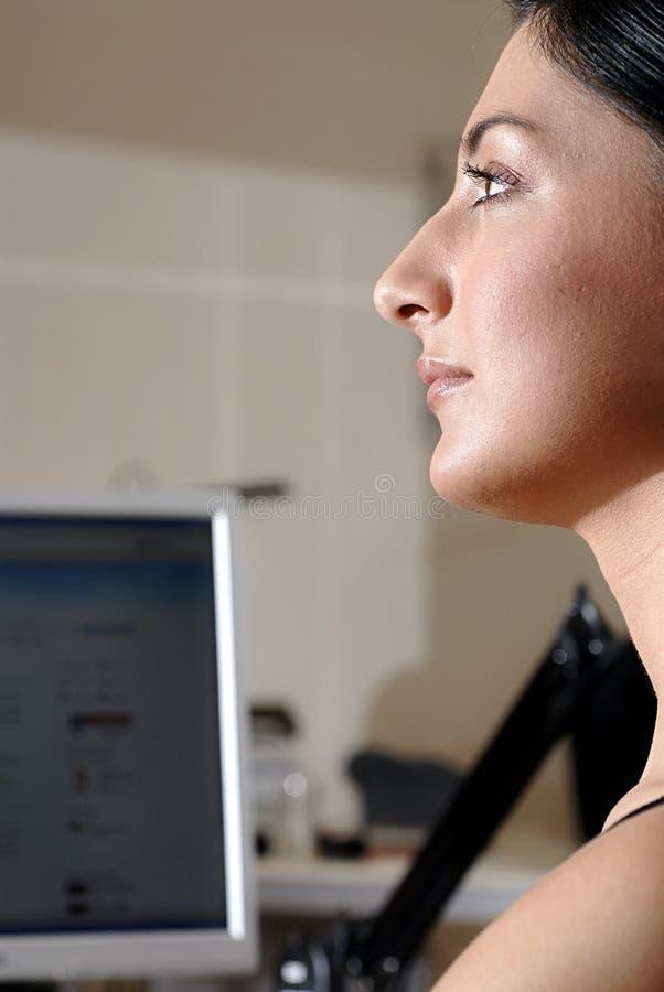 Woman at Computer stock photo