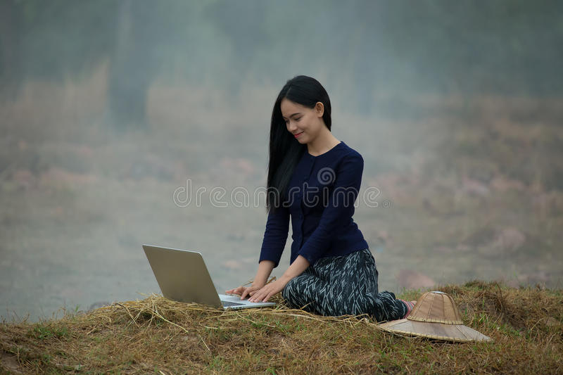 Woman computer on the countryside stock photos