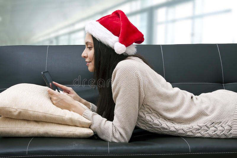 Woman with computer at home stock photos