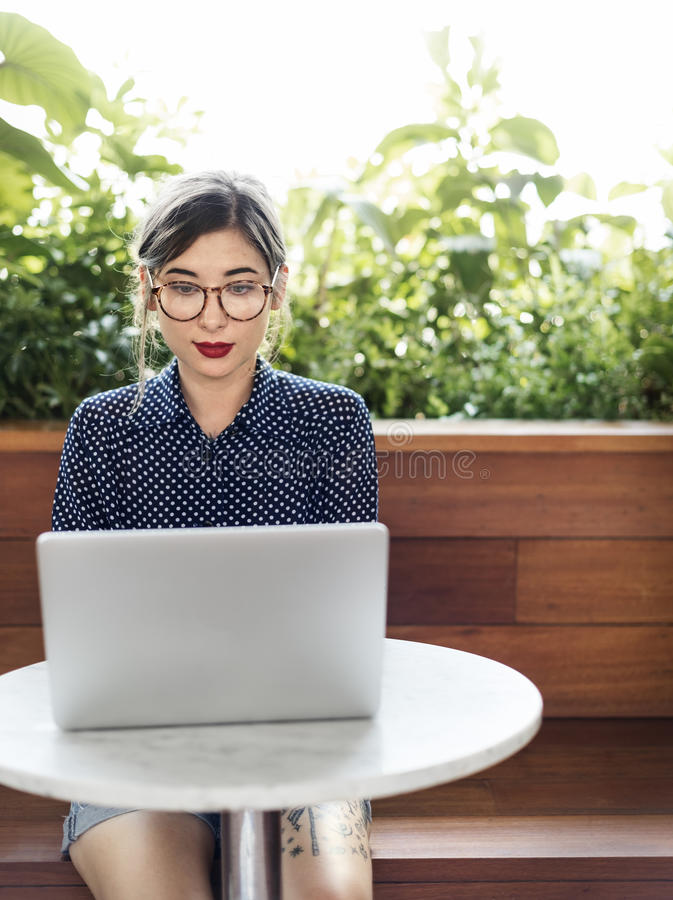 Woman Computer Internet Cafe Casaul Thinking Concept royalty free stock photo