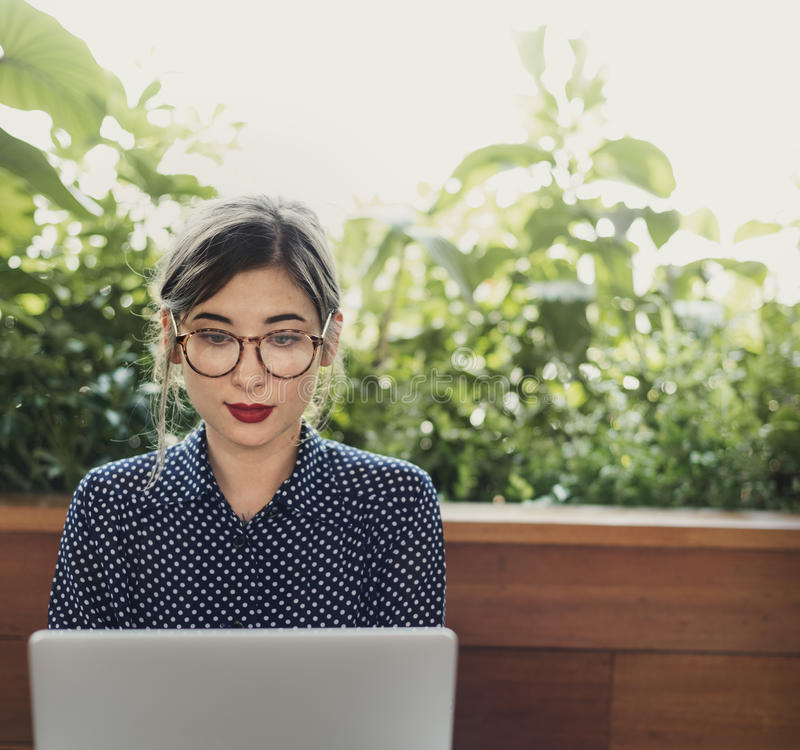 Woman Computer Internet Cafe Casual Thinking Concept royalty free stock photography