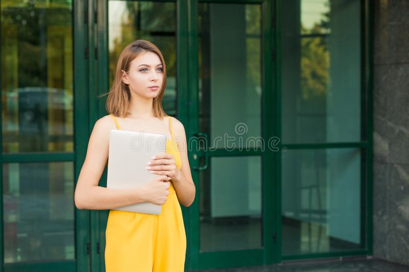 Woman with computer laptop posing royalty free stock photo