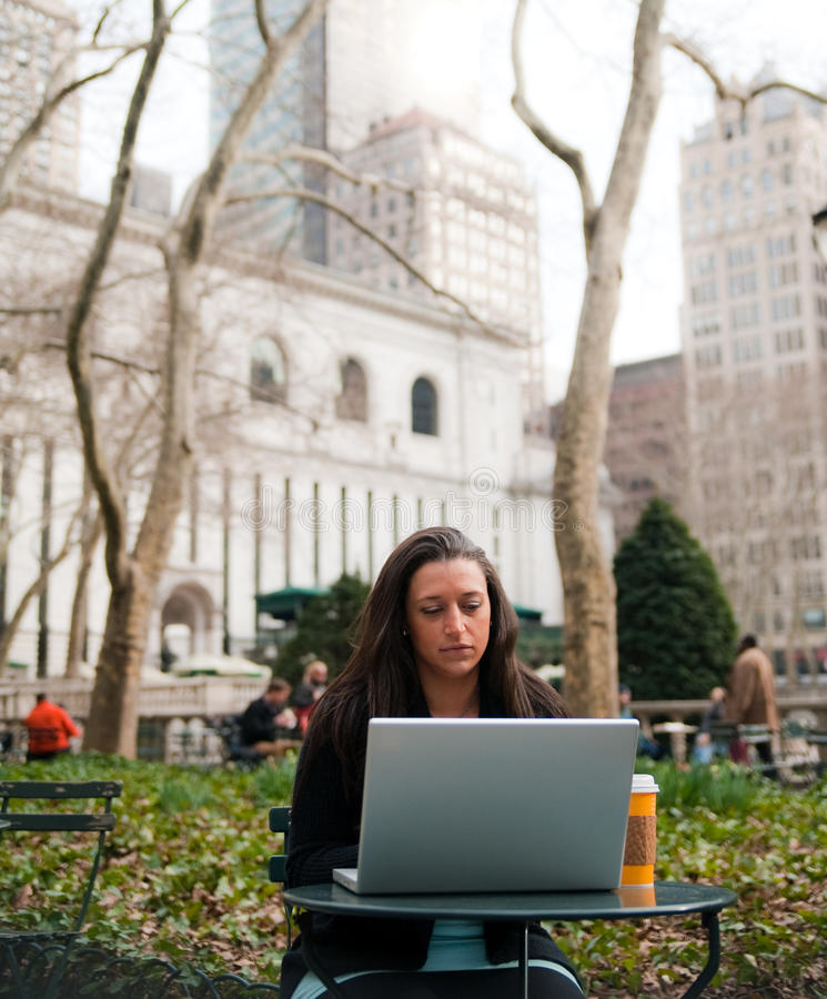 Woman With a Computer in a Park stock photography