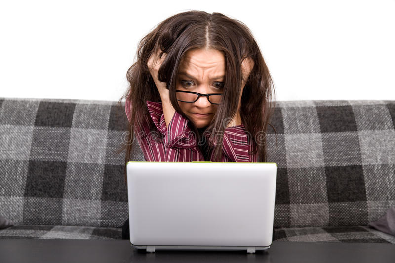 Woman with computer problems. Picture of a woman with computer problems royalty free stock image