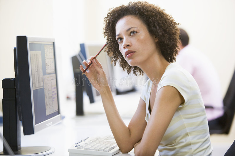 Download Woman In Computer Room Thinking Stock Photo - Image of woman, adult: 5708246