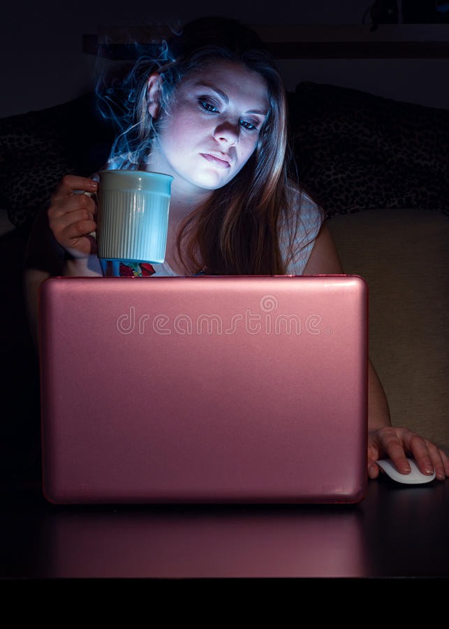 Woman at computer. With steaming cup royalty free stock photography