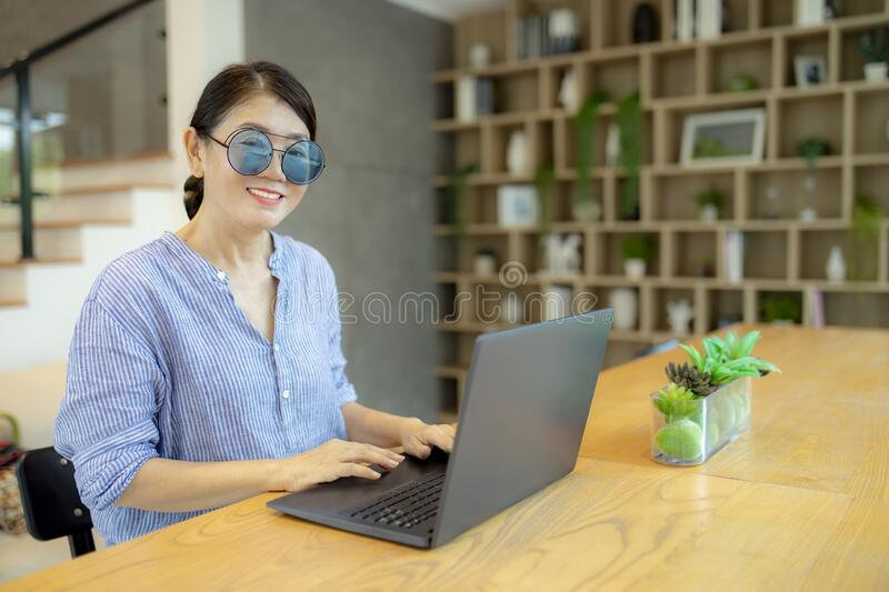 Woman concentrate working on laptop computer stock images