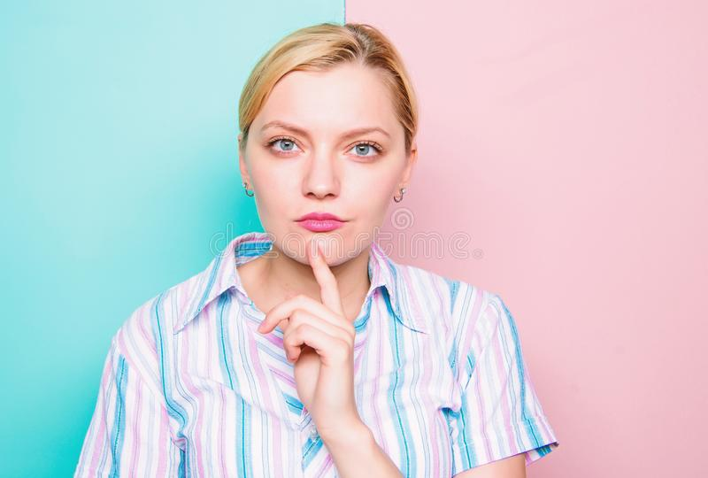 Woman concentrated face finger chin thinking. Need time to make decision. Come up with idea. Thinking about idea. Girl stock photo
