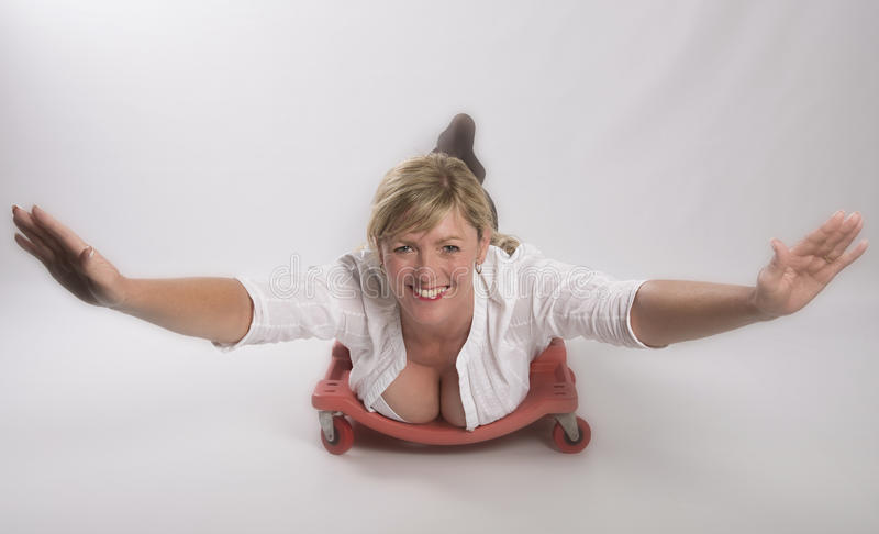Woman in a concept of flying. Woman wearing white open shirt in a concept of flying stock photos
