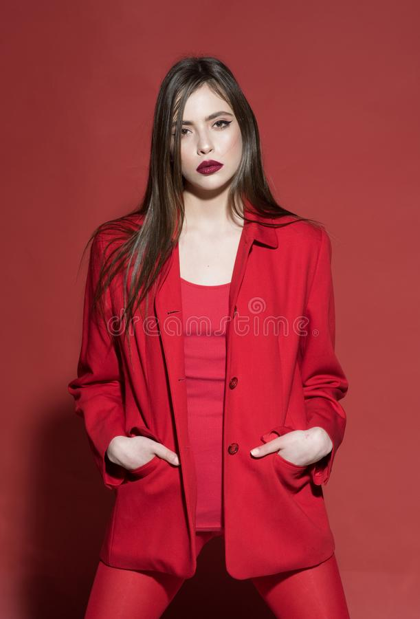 Woman concept. Pretty woman in red clothes. Woman with makeup and long hair. Fashion woman dressed with style. Find your. Inner diva stock photography