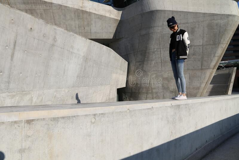 Woman On Concrete Wall Free Public Domain Cc0 Image