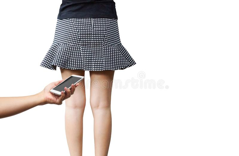 Taking pictures under her skirt. Woman confronted pervert taking pictures under her skirt royalty free stock image