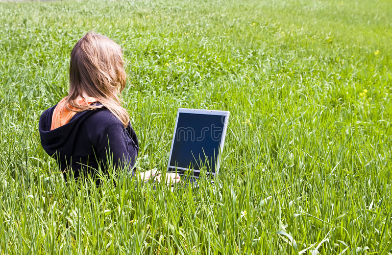 Woman connected on the grass