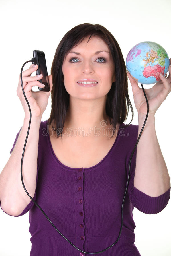 Woman connected to the world. Woman with her phone connected to the world royalty free stock photography
