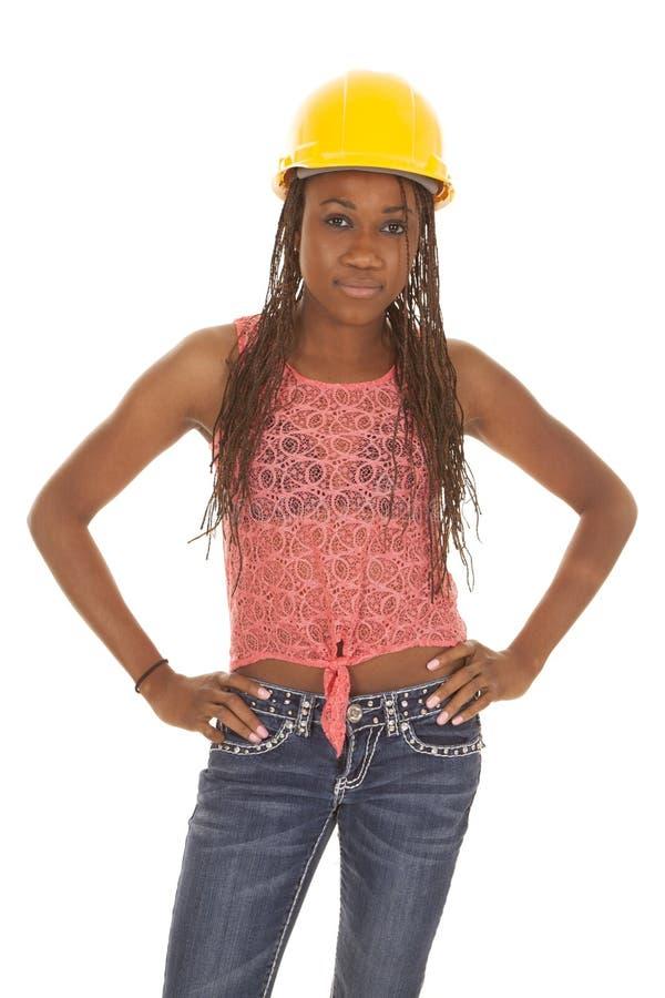 Woman with construction hat orange tank serous stock image