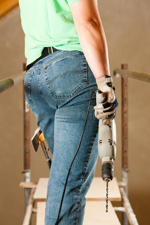 Free Woman Construction Worker With Hand Drill Royalty Free Stock Images - 16976469