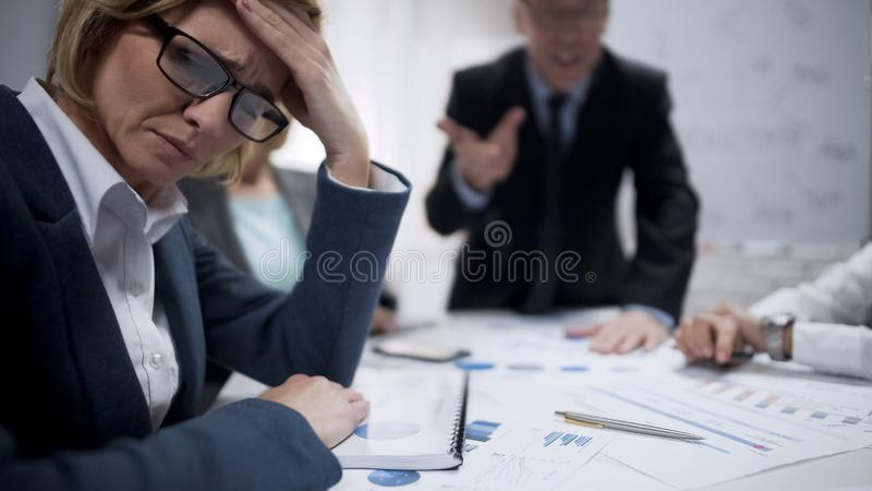 Woman consultant feeling stress at meeting, occupational burnout, overworked royalty free stock photo
