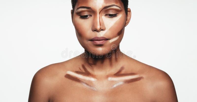 Woman with contour and highlight makeup. Close up of professional contour and highlight makeup. Contouring face makeup applying sample stock photos