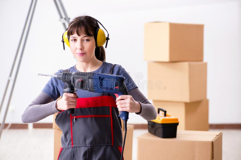 The woman contractor with hand drill at construction site royalty free stock images