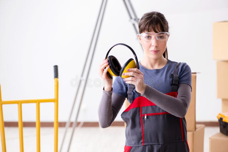 The woman contractor worker with noise cancelling headphones royalty free stock image