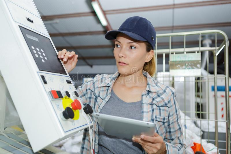 Woman control buttons machine factory operator. Female stock photos