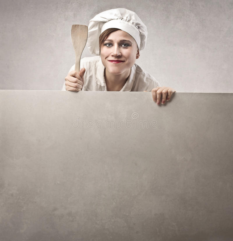 Woman Cook. Holding a wooden spoon royalty free stock photo