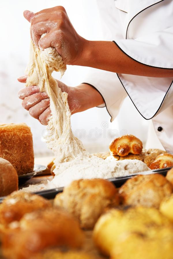 Woman cook with baked goods. Cook hands preparing dough for homemade pastry royalty free stock photography