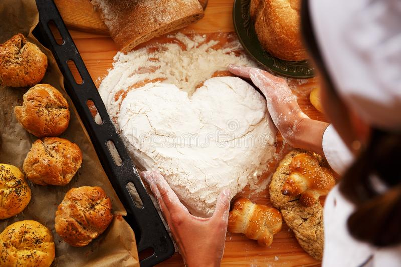 Woman cook with baked goods. Cook hands preparing dough for homemade pastry stock photo