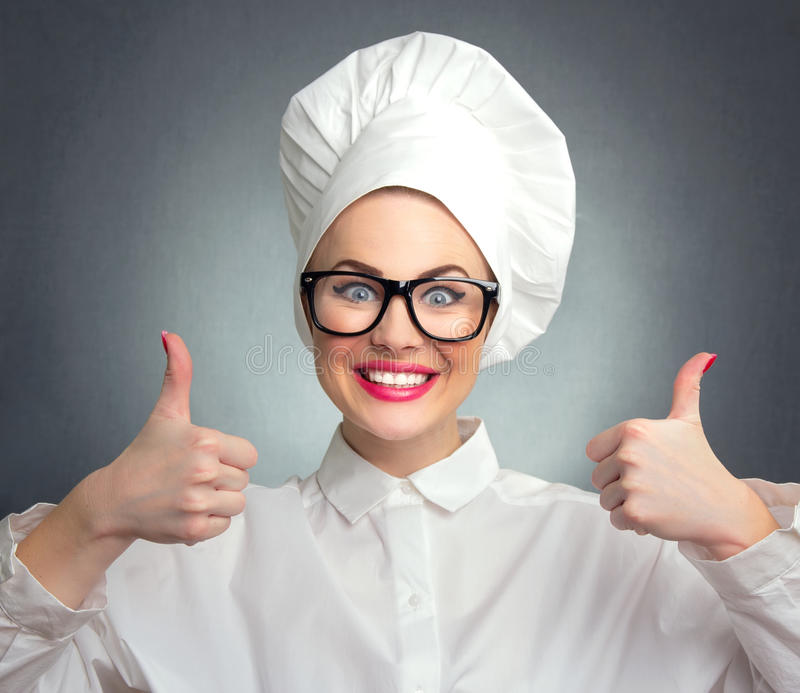 Woman cook, chef. Happy woman cook chef showing thumbs up, close up stock photo
