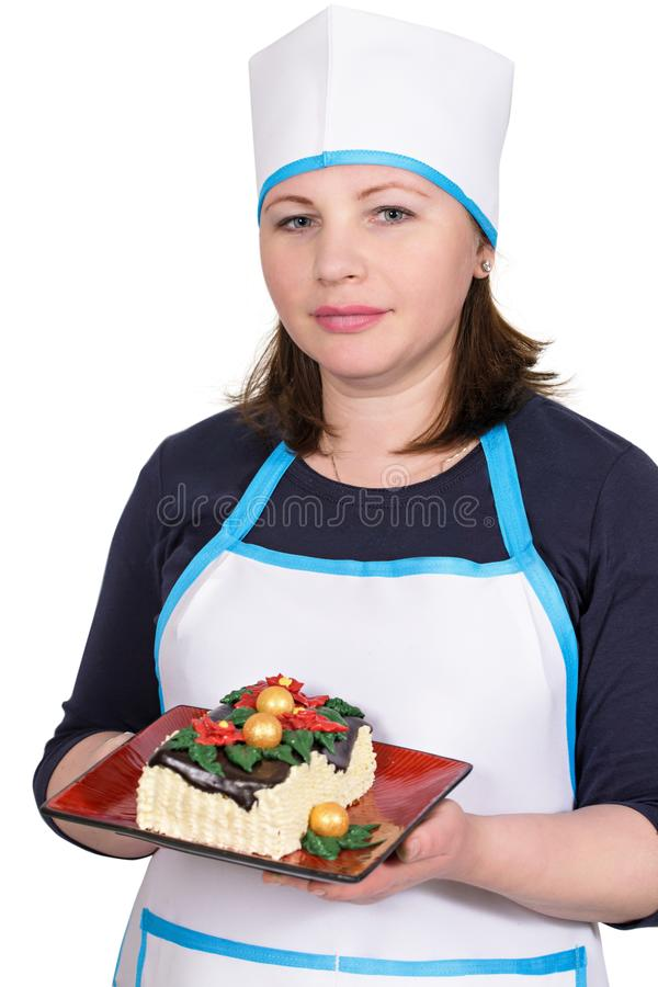 Woman cook holding a Christmas cake stock photos