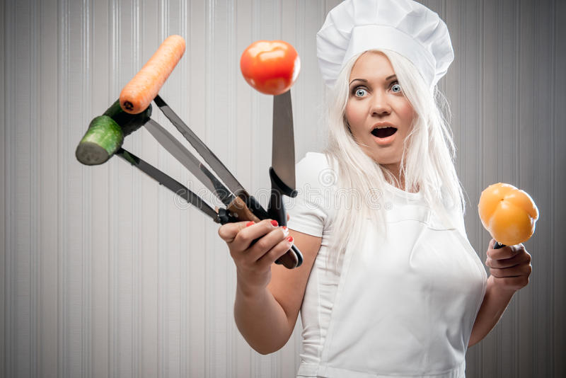 Woman cook with vegetables stock images